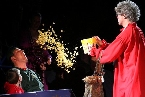 "080213 - Stone Mountain, Ga., : (all cq) Barry Lubin, ""Grandma"" of the U.S.A., throws a bucket of popcorn at the open mouth of Frankie Ashby, of Dacula, during the Big Apple Circus performs an afternoon show during their stay Wednesday afternoon in Stone Mountain, Ga., February 13, 2008. After failed attempts at getting a piece of popcorn in Ashby's mouth Grandma dumped the whole bucket at Ashby. Ashby was there with his family. The Big Apple Circus is celebrating their 30th birthday under the big top. Jason Getz  /  AJC"